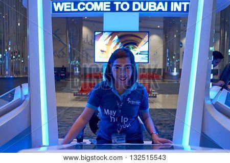 DUBAI, UAE - APRIL 08, 2016: Dubai International Airport staff. Dubai International Airport is the primary airport serving Dubai, United Arab Emirates