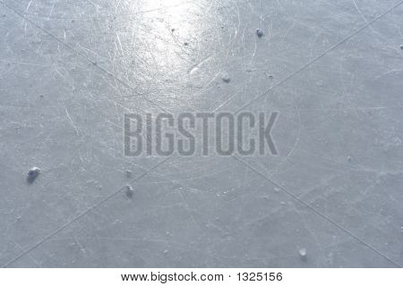 Sun Reflecting In The Surface Of An Ice Rink