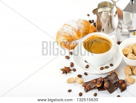 close up of freshly prepared cup of Italian espresso with cinnamon coffee beans brown sugar