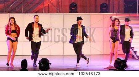NEW YORK-JAN 12: Valentin Chmerkovskiy (2nd L) and Mark Ballas (C) perform at Dancing with the Stars: Live! Tour at the Beacon Theatre on January 15, 2015 in New York City.