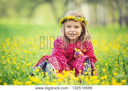 Portrait of happy little girl in spring park