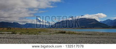 Distant view of Mt Cook. Morning scene in New Zealand. Shore of Lake Pukaki.