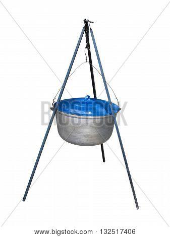 Tourist pot with blue cap hanging on a tripod