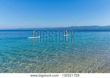 Brac Croatia - May 07 2016: standup paddle boarders at Zlatni Rat beach Croatia