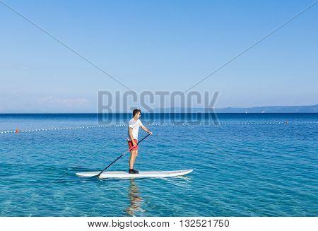 Brac Croatia - May 07 2016: standup paddle boarder at Zlatni Rat beach Croatia