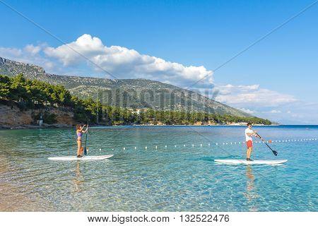 Brac Croatia - May 07 2016: standup pddle boarders at Zlatni Rat beach Croatia