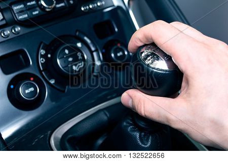 Close-up of gear stick from manual gearbox. Conception of driving a car