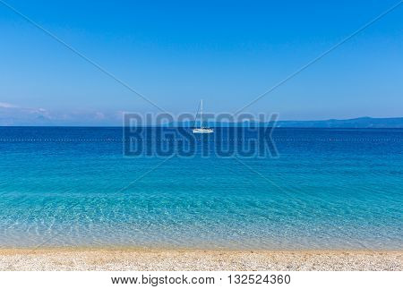 Brac Croatia - May 07 2016: yacht at Zlatni Rat beach Croatia