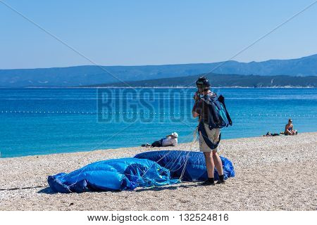 Brac Croatia - May 07 2016: Parachutist on Zlatni Rut beach