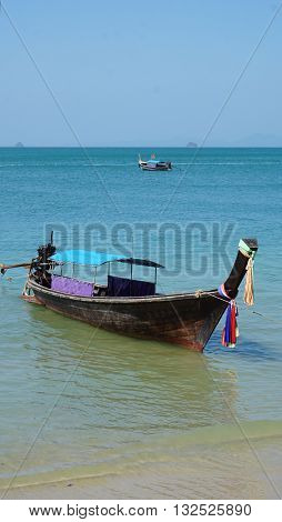 traditional thai longtail boat at the beach