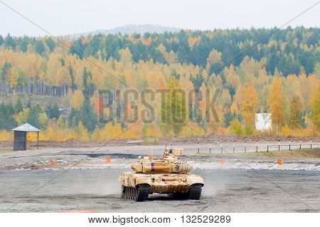 Nizhniy Tagil, Russia - September 25. 2013: Russian military tank T-90S move through Obstacle overcoming. Russia Arms Expo RAE-2013 exhibition