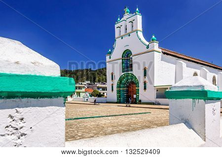 Chamula Mexico - March 25 2015: Ornate exterior of Templo de San Juan Bautista in Chamula an indigenous town with unique autonomous status in Mexico & no outside police force near San Cristobal de las Casas Chiapas