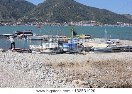 21ST JULY 2016, FETHIYE, TURKEY: Fishing boats moored along the coastline at Fethiye in Turkey, 21st july 2016