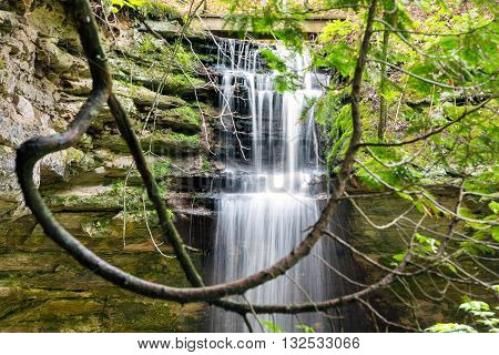 Memorial Falls surrounded by lush green foliage at Pictured Rocks National Lakeshore in Munising Michigan