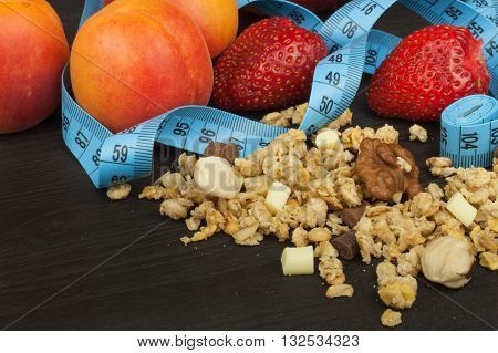 Spilled Cheerios cereal with chocolate. Healthy dietary supplements for athletes. Cheerios for breakfast. Muesli and fruit. The diet for weight loss. Muesli to eat. Sweet muesli.