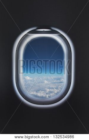 Clouds in the aircraft's porthole, looking through the window