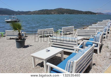 FETHIYE, TURKEY, 27TH MAY  2016:A restaurants seating area with boating in the background along the promenade in Fethiye, Turkey, 27th may 2016