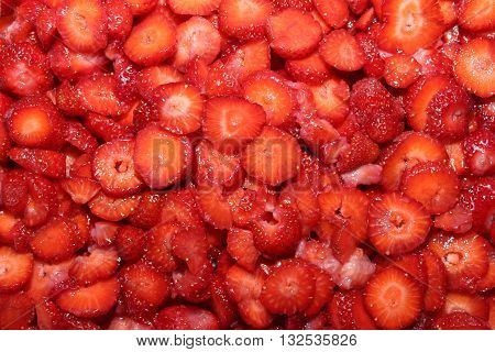 Strawberry fruit is widely appreciated for its characteristic aroma bright red color juicy texture and sweetness. Background of many strawberries.