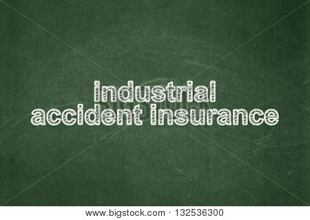 Insurance concept: text Industrial Accident Insurance on Green chalkboard background