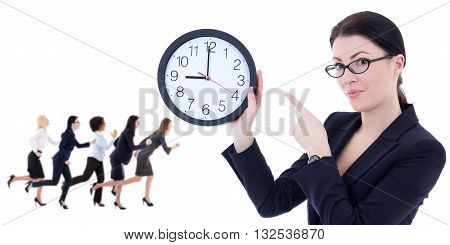 Business And Time Concept - Young Woman Holding Office Clock And Her Running Colleagues Isolated On