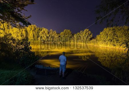 Fisherman in night , Night Fishing, Carp Rods, starry night reflection on lake