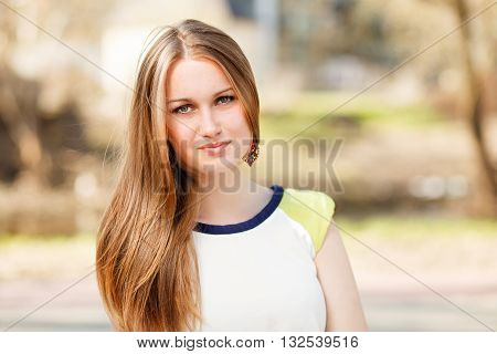 A Long hair happy girls portrait outdoor.
