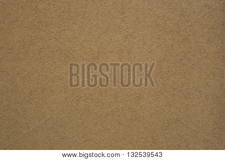 Texture of brown beige plaster wall background
