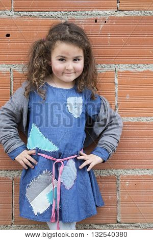 Smiling cute girl dress like a homeless with dirty face