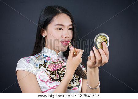 Beautiful Young Asian Woman Applying Makeup