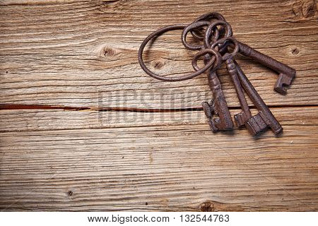 old keys on a wooden table, close-up