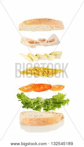 sandwich with lettuce tomato chips cheese and ham