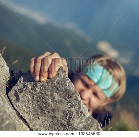 Young man finishing his extreme mountain climb