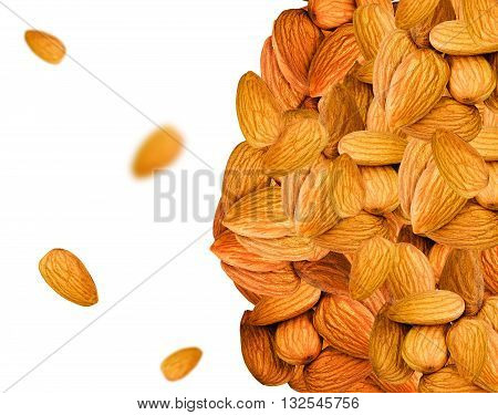 Almonds background with blurred and sharp pieces. Fresh raw almonds background. Brown almond nuts isolated on white. Healthy food nuts.