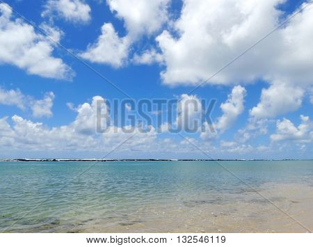 View of the rock barrier at Barra de São Miguel beach in Alagoas, Maceio, Brazil.