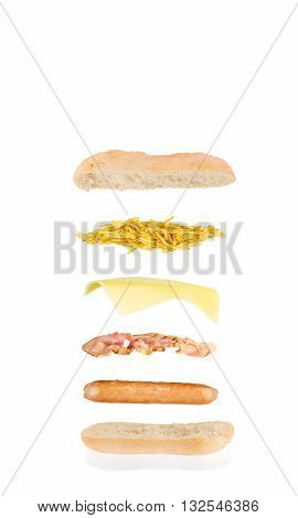hot dog sandwich with sausage bacon cheese and chips