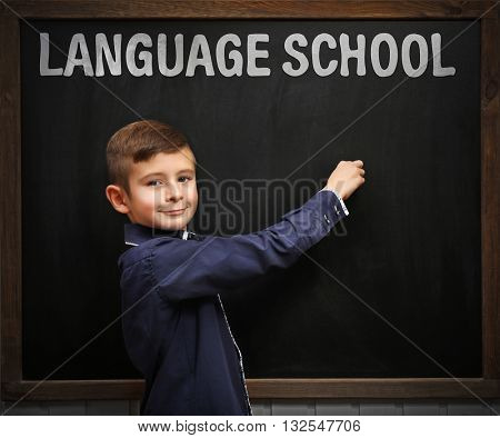 Language school concept with schoolboy