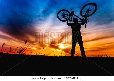 Outdoors Lifestyle For Healthy Concept. Action Of Winner And Successful People, Cyclist Raising Bike