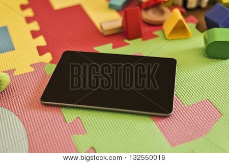 close up of a tablet device on a childrenâ??s playground, digital gaming concept