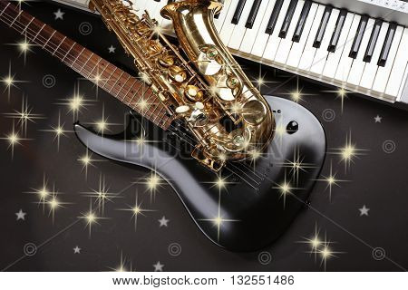 Musical instruments on dark background with snow effect