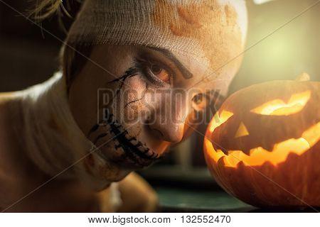 Horrible girl with halloween pumpkin