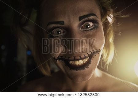 Horrible girl with scary mouth and eyes