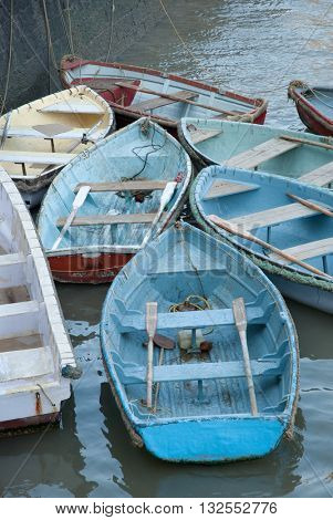 Colorful rowboats docked in the Arabian Sea near the Gateway of India in Mumbai, India.