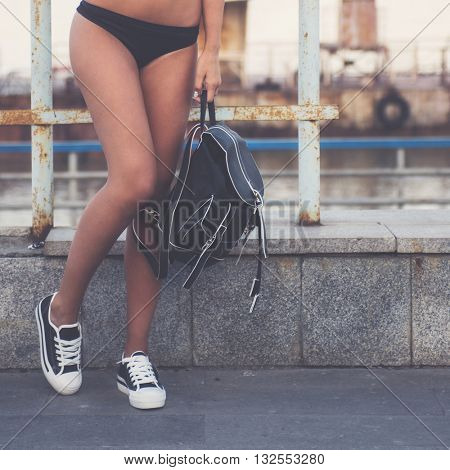 closeup of woman legs in white gumshoes