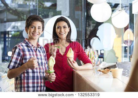 Mother And Son Having Vanilla Ice Creams At Counter