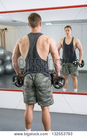 Back View Of A Confident And Masculine Man At The Gym