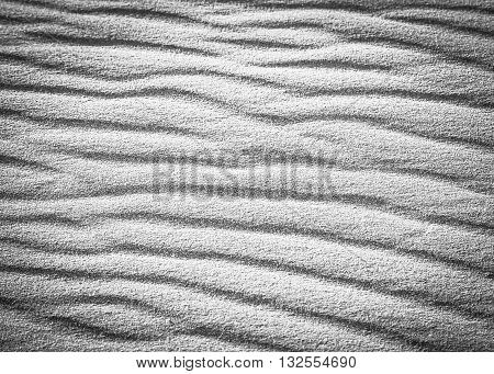 Black and white highly contrasted pattern in the beach sand on the sand dunes in the desert