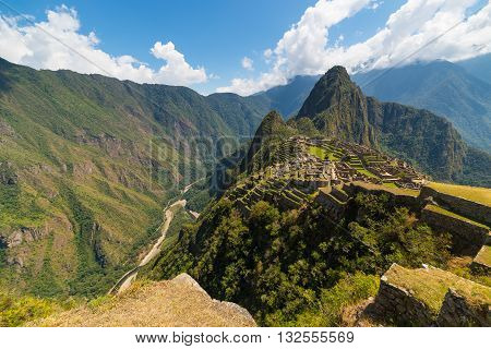 Machu Picchu Archeological Site Illuminated By The Sunlight. Wide Angle View From The Terraces Above