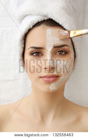 Young woman having mask procedure