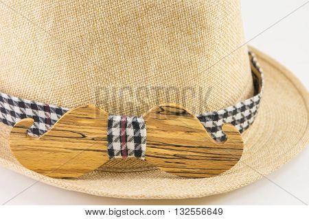Wooden bow tie around a hat. Man accessories