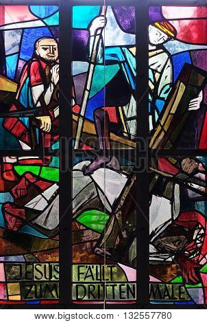 KLEINOSTHEIM, GERMANY - JUNE 08: 9th Stations of the Cross, Jesus falls the third time, stained glass window in Saint Lawrence church in Kleinostheim, Germany on June 08, 2015.